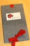 The front cover of the MPL printing, showing the ribbon and bow.